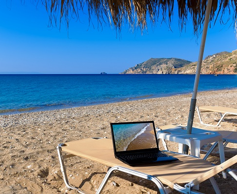 image of computer on beach