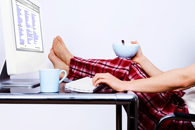 Image of someone having breakfast while working at computer in PJs.