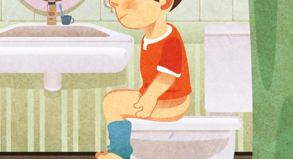 Image of little boy learning to use the toilet