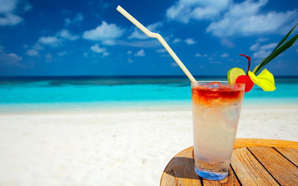image of beach and cocktails
