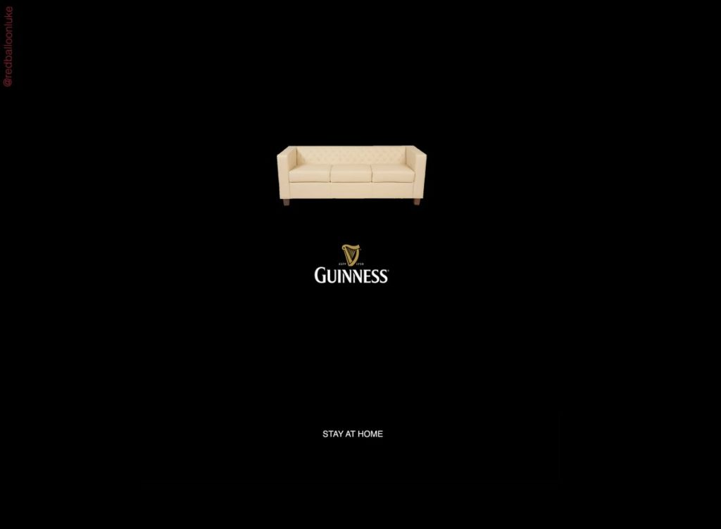 Image of pint of Guinness comprising a white sofa with message stay at home