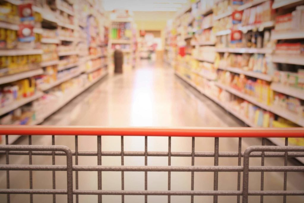Shopping trolley in an empty supermarket