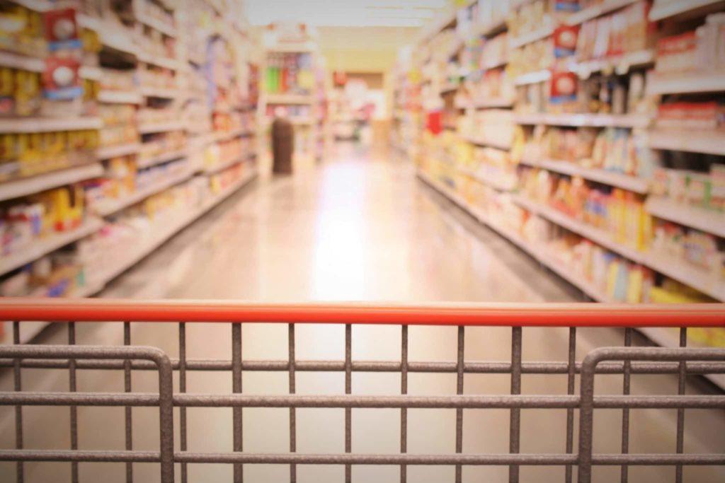Shopping trolley in an empty supermarket